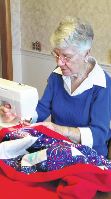Joyce Jones works on a quilt for a hospice patient. She has made more than 2,000 quilts for Wilson Health hospice patients.