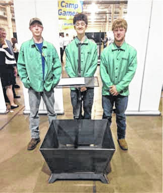 The Fort Loramie FFA team placed second overall at the Agricultural Mechanics Engineering competition at The Ohio State University. The team, whose members include, left to right, Jordan Drees, James Keller, and Austin Meyer. The teams task was to design and weld a fire pit and were graded on stick welds, wire welds, safety, teamwork, and their portfolio.
