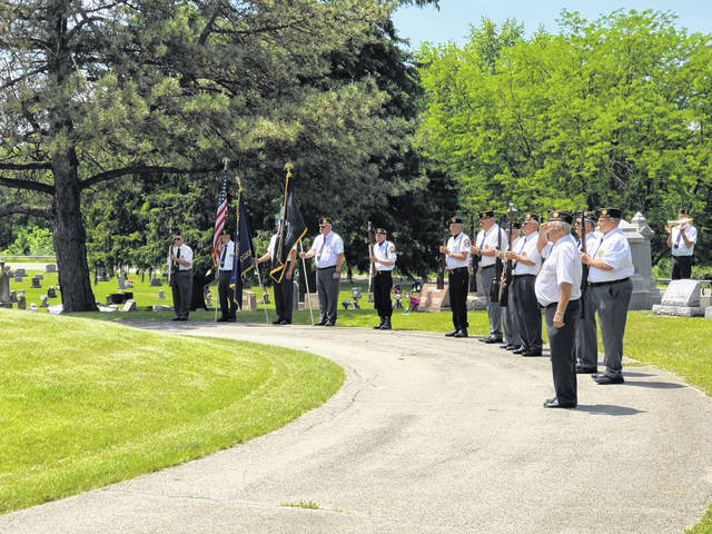 American Legion Post 217 Firing Squad prepare for the 21-gun salute during Memorial Day services Sunday at Cedar Point Cemetery in Pasco.