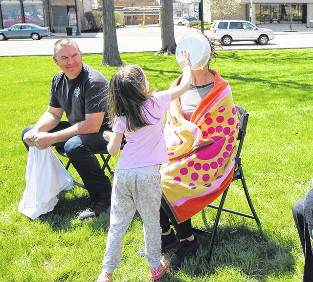 Audrey Teasel, 4, daughter of Sara Elliott, of Sidney, was the lucky winner who got to throw a pie at Heather Fogt Monday during CASA Day at courtsquare. Fogt is the CASA volunteer coordinator. CASA Director Bridget Davis was also a winner and got to throw a pie at Sidney Fire Lt. Jason Truesdale.