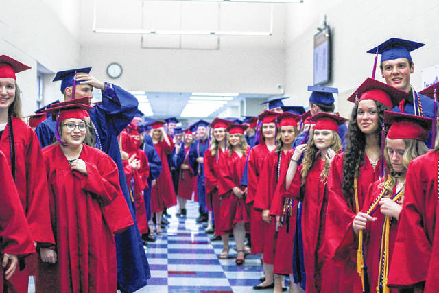 Members of the Riverside High School Class of 2018 line up in the hallway as they wait for Friday night's graduation ceremony to begin.