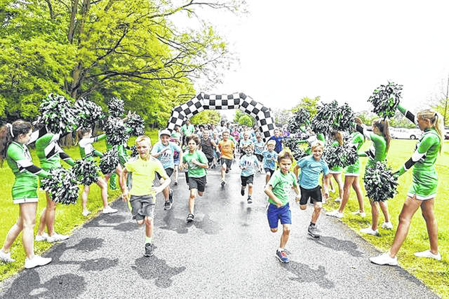 Children open a previous Sidney Great Strides 5K to raise money for cystic fibrosis research. This year's event will be May 20 in Custenborder Field in Sidney.
