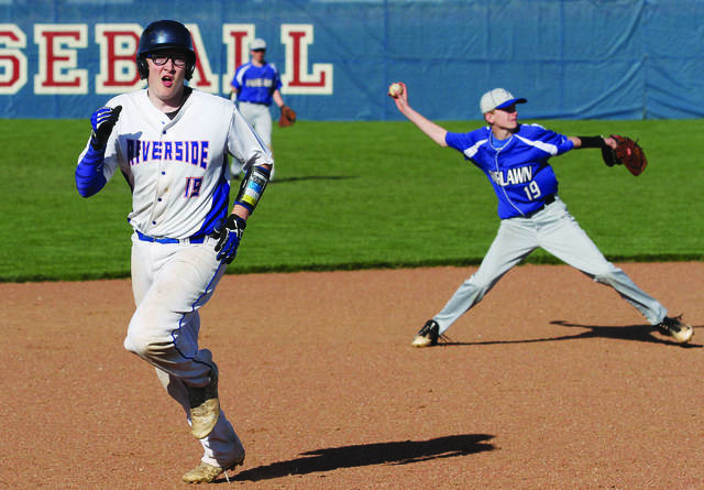 Riverside's Justin Ritzma runs towards third as Fairlawn's Keith Orndorff prepares to throw to first base during a nonconference game on April 27 in De Graff. Riverside beat the Jets 10-9 in a Division IV sectional opener on Monday in De Graff.