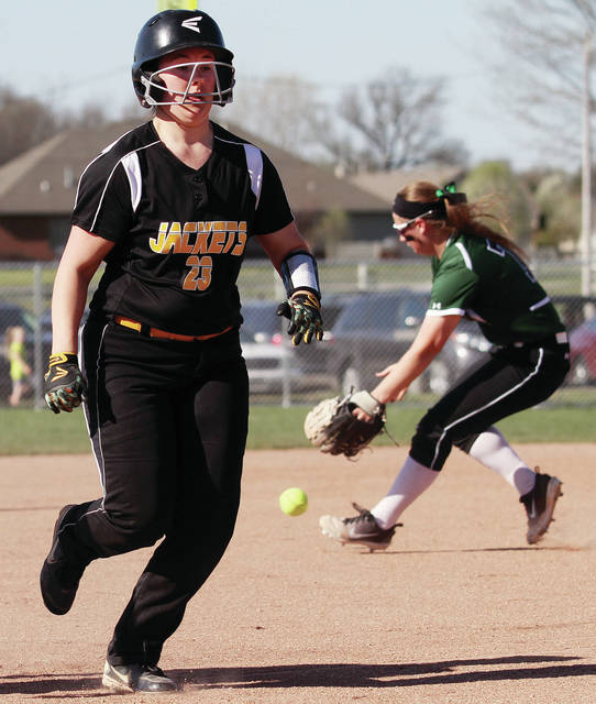 Sidney's Allie Herrick runs for third as Greenville's Zoe Pressnall chases down the ball during a Greater Western Ohio Conference American North Division game on Tuesday at Greenville.