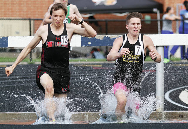 Fort Loramie's Jake Rethman, left, and Sidney's Gavin Bockrath compete in the steeplechase on Thursday in the Firebird Invitational in Kettering.