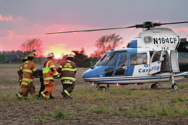 Anna firefighters take Gabriel Davis Ludington, 16, of Botkins, to a waiting Careflight helicopter. The person was injured when the four wheeler they were riding crashed into a utility pole at 15960 Meranda Road around 8 p.m. Sunday, May 6.