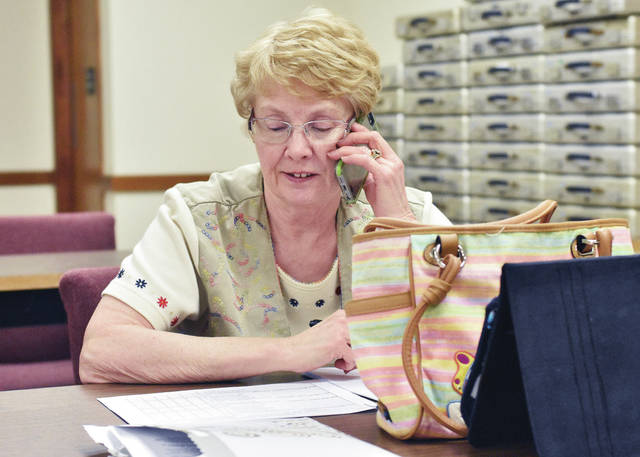 Former Sidney Daily News reporter Christine Henderson came out of retirement to relay election results to the Associated Press at the Shelby County Board of Elections Tuesday, May 8. Henderson worked at the SDN for 25 years before going to the Celina Daily Standard in 2000 where she stayed until she retired in 2012.