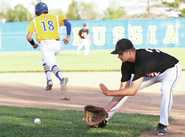 Fort Loramie's Jared Middendorf fields a ground ball as Russia's Evan Monnier runs to second during a Shelby County Athletic League game on Thursday in Russia.