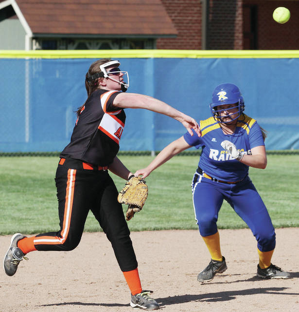 Russia's Claudia Counts waits for Ansonia's Heidi Rumkel to throw before taking off for third base during a Division IV sectional semifinal on Thursday in Russia.
