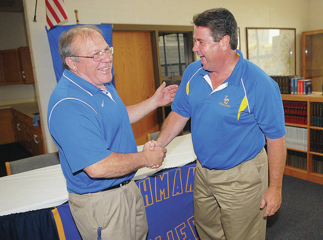 Lehman athletic director Dick Roll, left, congratulates Tim Gleason shortly after Gleason was introduced as the boys basketball program's coach in May of 2015. Lehman announced earlier this week Gleason would not return next season.