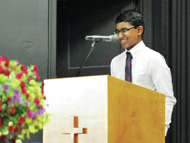 Adith Joshua George gives the valedictorian address during the Holy Angels 8th grade graduation ceremony Tuesday, May 22.