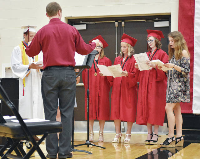 Fort Loramie High School seniors are directed by Kyle Knapke in the High School Choir one last time during their graduation ceremony Sunday, May 27.