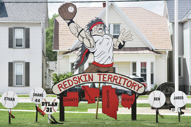 "Fort Loramie's ""Redskin Territory"" display along state Route 66 has been decorated for the baseball team's state berth. Among the decorations includes a mustache. The team has adopted a ""Fear the Mustache"" mantra after third baseman/pitcher CJ Billing, who grew a mustache after a joke from coach Jeff Sanders."