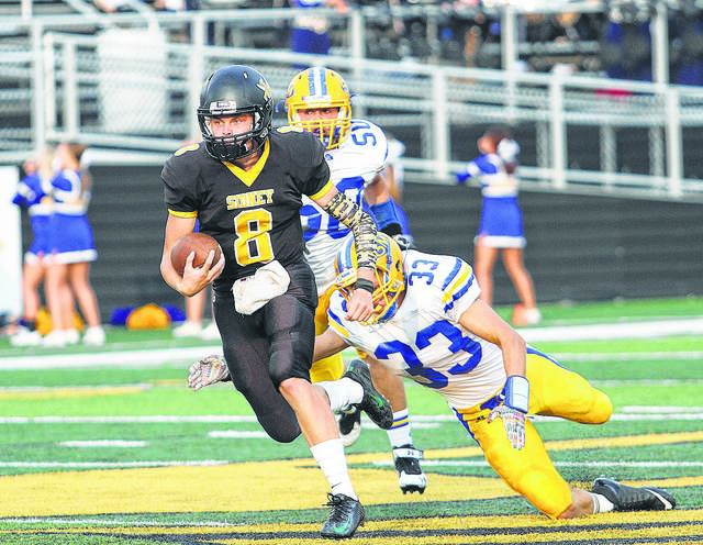 Sidney's Jack Feazel finds room to run as St. Marys' Julius Fisher dives into the ground from behind at Sidney Memorial Stadium on Aug. 28, 2015. The two schools have opened the season every year since 1983 but will cease playing in 2020.