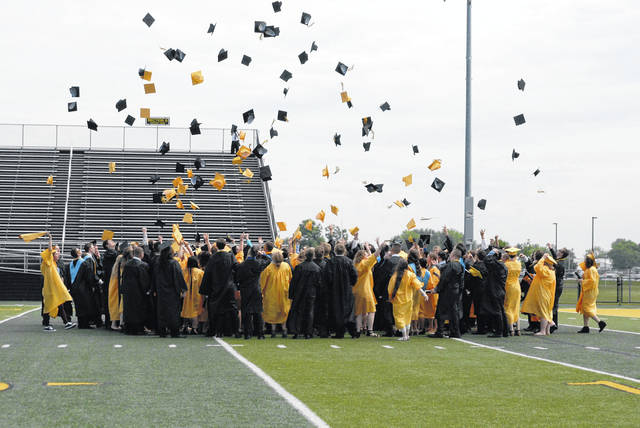 Sidney High School Class of 2018 members celebrate the end of Saturday's graduation ceremony by tossing their caps into the air. More photos from the weekend's graduation ceremonies can be found on Pages 1-13B.