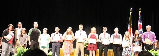 Sidney High School Music Booster President Stephanie Wilson, left to right, band director Chris Adams, orchestra director Janet Fu and choir director John Young congratulate the 2018 scholarship recipients Jennifer Barnes, Evan Burden, Laura Brady, Gavin Miller, Jenna Beatty, Avery Voress, Lucas Finke, Avaka Machimura, Jenna Bermand and Caleb Straman.