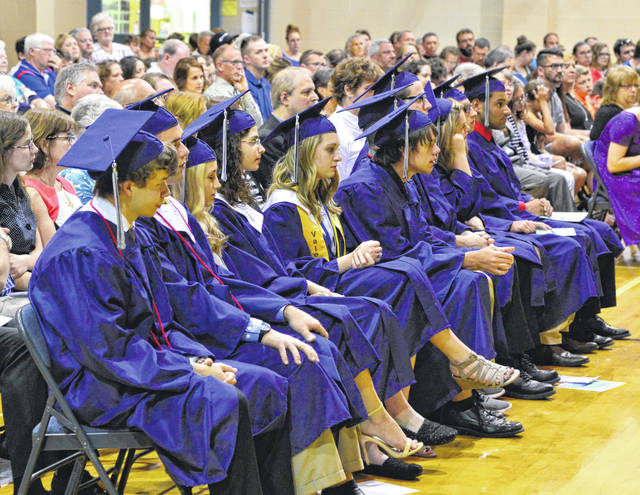 Members of the Class of 2018 at Christian Academy Schools listen to the speakers during the ceremony.