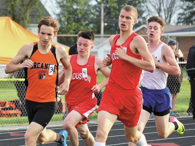 Houston's Tristin Friesthuler (No. 4) and Ethan Knouff run in the 1,600-meter run on Friday at the Covington Invitational. Friesthuler and Knoff finished second and third, respectively.