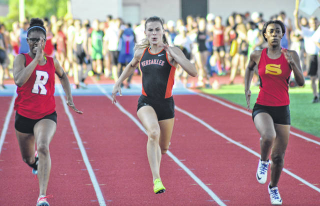 Versailles' Ava Moran heads towards the finish line in the 100-meter dash during the Division II regional meet on Thursday at Alexander Stadium in Piqua.