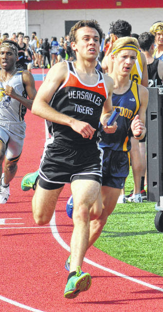 Versailles' Brooks Blakeley competes in the 4x800 relay during the Division II district meet on Thursday at Alexander Stadium in Piqua. Versailles won in 8:17.