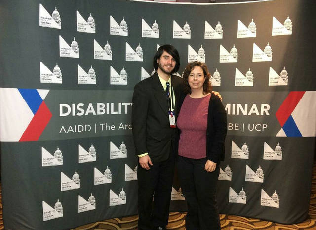 Blaine O'Leary and his stepmother, Betsy O'Leary, both of Sidney, stop for a photo opportunity during the Disability Policy Seminar in Washington, D.C., recently.