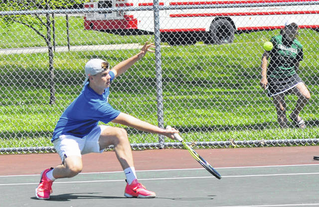 Lehman Catholic's Danny Lins goes low to hit a volley against Northeastern on Tuesday.