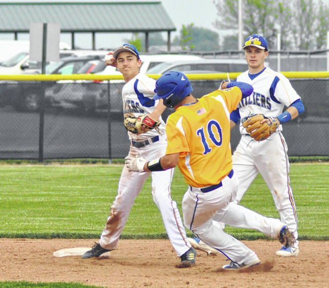 Russia's Carter Francis breaks up a double play as Lehman shortstop Alex Keller attempts to throw to first as Tyler Lachey looks on Wednesday at Newton High School.
