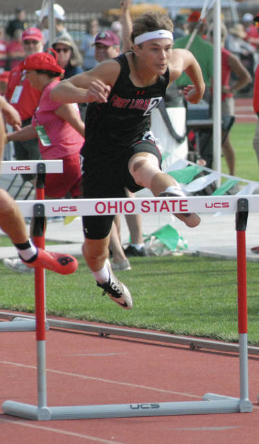 Fort Loramie's Jarrett Meyer competes in the 110 hurdles during the state track meet on Saturday at Jesse Owens Stadium in Columbus. Meyer finished ninth.