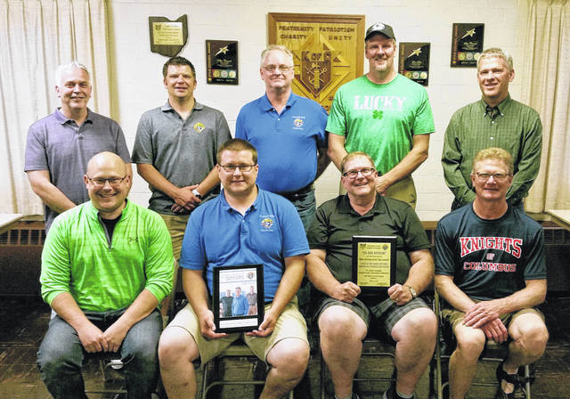 Members of the Minster Knights of Columbus display the awards they received at the state convention. Pictured are the St. Pat's dance committee members, left to right, front row, Matt McDermitt, Matt Albers, Kevin Steinemann and Roger Rutschilling; and back row, Terry Prenger, Dave Heckman, John Winner, Tim Bertke and Dave Knapke.