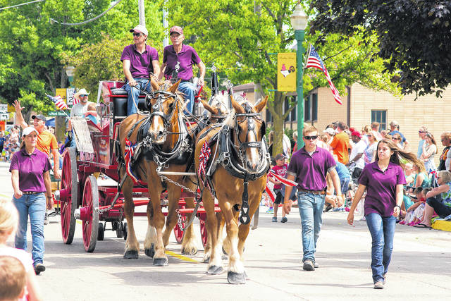 A horse-drawn wagon was one of the entries in a previous parade during Poultry Days in Versailles.