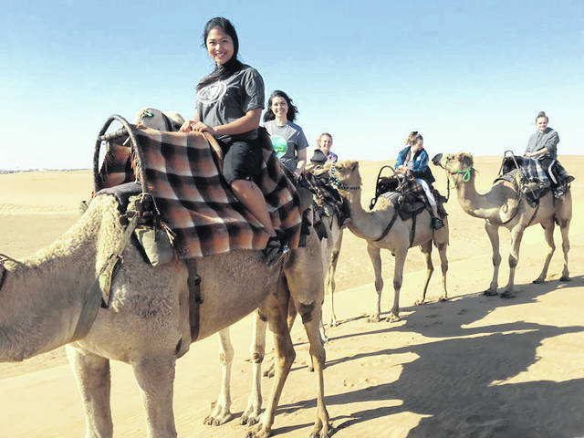 Jessica Witer, of Anna, second from left, rides camels for fun in Namibia.