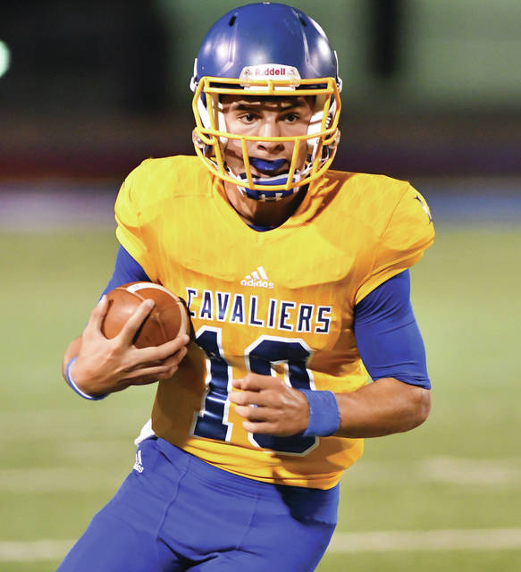 Lehman quarterback Elliott Gilardi runs in the third quarter of a nonconference game against Graham on Sept. 9, 2017 at Alexander Stadium in Piqua. Should the Cavaliers make the playoffs, they would play their postseason games on Saturday nights. Last season, Lehman's playoff games were on Friday nights.