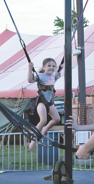 Ayla Lewis enjoys the aerial bouncing Friday night at the Anna Homecoming. Ayla is the 5-year-old daughter of Courtney and Brent Burns, of Anna, and Brandon Lewis, of Sidney.