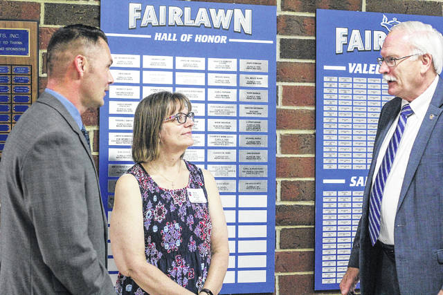 Fairlawn Local Schools 2018 Hall of Honor inductees visit with each other during ceremonies, Saturday, June 2, at the school in rural Sidney. They are, from left, U.S. Air Force Chief Master Sgt. Michael Sloan, of Navarre, Fla., a 1995 Fairlawn graduate; Karen (Peters) Woolum, of Marysville, a 1978 graduate; and Sidney Mayor Mike Barhorst, of Sidney, a 1968 graduate.