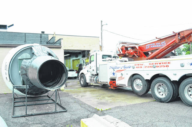 The replica Gemini capsule from the Armstrong Air and Space Museum was transported to Auglaize Auto Body in Wapakoneta Tuesday for restoration.