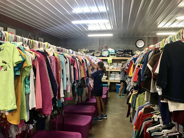 Sorting clothes at Rustic Hope in Russia