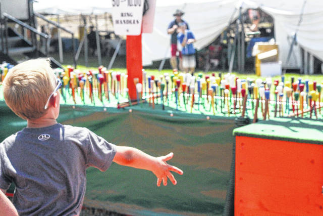 MJ Schoenlein, 5, son of Angie and Matt Schoenlein, of Maria Stein, tries to win a cane at the cane toss game.