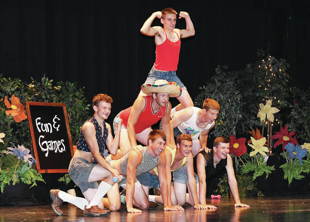The escorts for the 2018 Botkins Carousel Queen candidates perform for the crowd as part of the entertainment acts Friday, June 8.