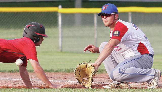 Sidney Post 217's Kyle Noble tries to pick off Troy Post 43's Keaton Mohler during a game at Custenborder Field on Tuesday.