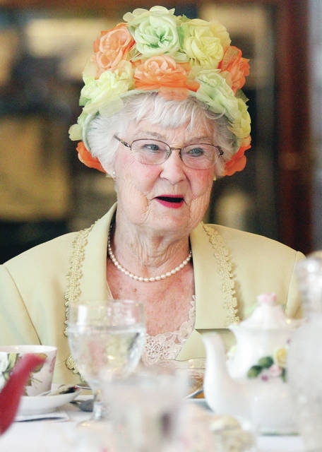 "Shirley Hillier, of VanWert, wore a flowery hat and pearl necklace to the event ""Afternoon Tea with the Shelby County Historical Society"" Wednesday, June 13. The tea party was held at the Ross Historical Center. Faye Spangler, of Anna, gave a presentation in the character of Lois Lenski on the world and Sidney in the early 20th century. Salmon sandwiches, wraps and scones were some of the other foods offered during the tea party."