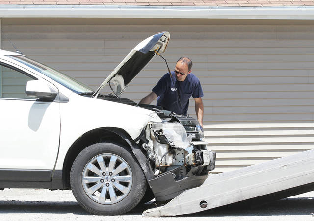 A car is towed from the scene of a three-vehicle accident at the intersection of state Route 119 and state Route 29, Thursday, June 28. The crash occurred shortly after 2 p.m. It remains under investigation by the Shelby County Sheriff's Office.