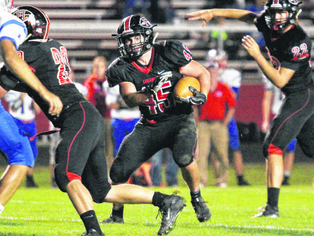 Fort Loramie's Mike Hoying, left, runs the ball as Austin Siegel fakes a pass during a game against Tri-Village on Oct. 13, 2017 in Fort Loramie.