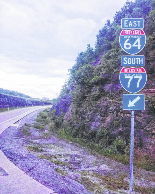 The sign says it all: Rudy Langenkamp traveled through the hills of West Virginia during his hitchhiking trip this summer.