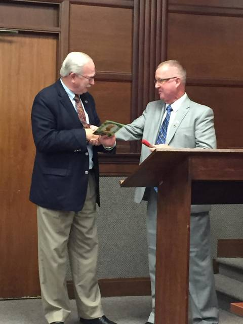 """Mayor Mike Barhorst recieves the """"Big Dill Award"""" on his birthday from Council member Darryl Thurber during the Sidney City Council meeting Monday."""