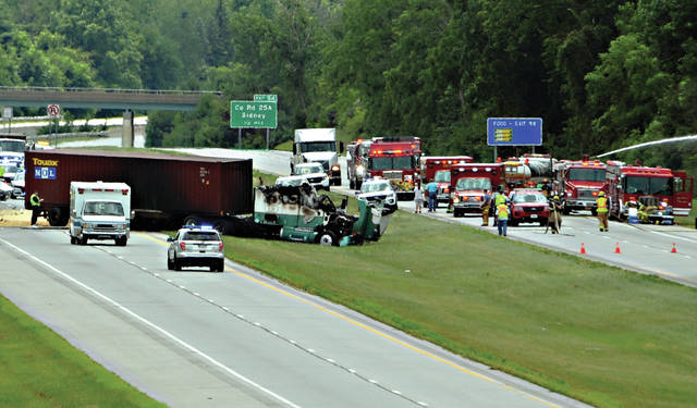 Mike Ullery | AIM Media Midwest Emergency crews, including Ohio State Highway Patrol, along with fire and EMS from multiple departments work the scene of a crash on I-75 near the 95 mile marker on Thursday afternoon.