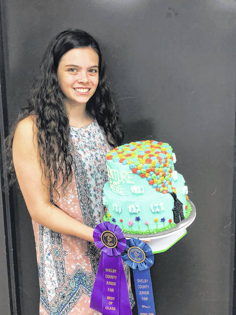 Brianna Holtzapple, 16, daughter of John and Jennifer Holtzapple, of Anna, won best of class, outstanding of the day and state fair qualifier with her decorated cake at the Shelby County Fair. She is a member of the McCartyville Producers.