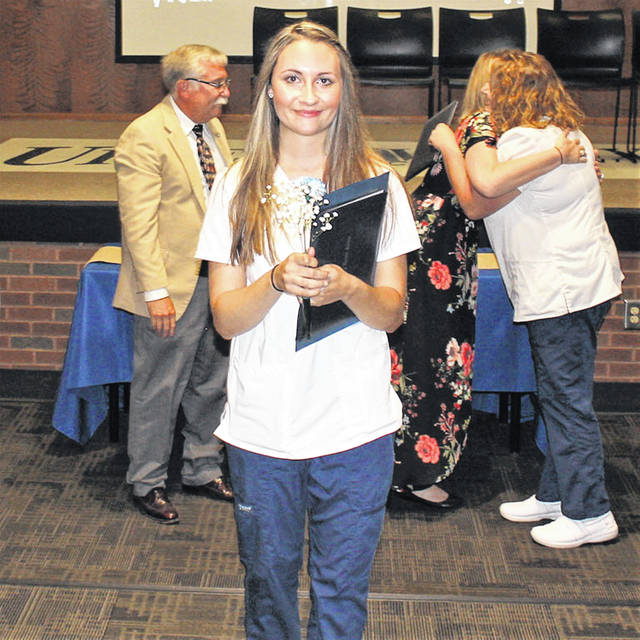 """<style type=""""text/css""""></style> <p style=""""margin-bottom: 0in; line-height: 100%;"""">Cheyann Berryhill, of Sidney, exits the stage after receiving her diploma as a practical nurse. Graduation ceremonies were at Upper Valley Career Center in Piqua, Thursday, July 26."""
