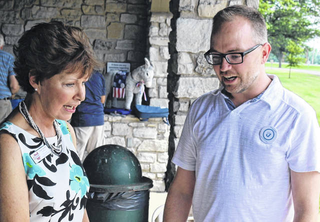 Janet Garrett talks with Joe Monbeck at the Auglaize and Mercer County Democratic Parties Summer Potluck Picnic at Grand Lake St. Marys. Garrett is running for the 4th Congressional District, while Monbeck is running for the Ohio State House District 84.