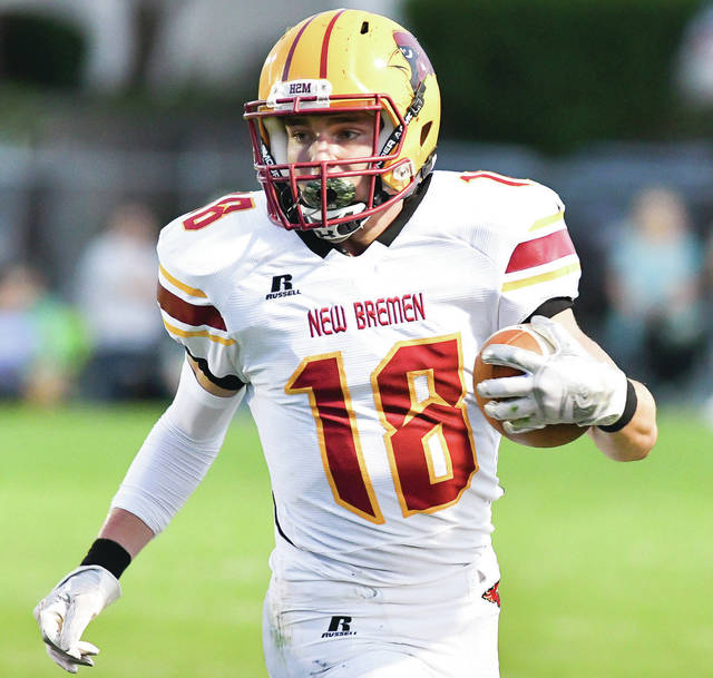 New Bremen running back Avery Powers looks downfield during a carry in the first quarter of a Midwest Athletic Conference game against Anna on Sept. 15, 2017. Powers was first team all-Midwest Athletic Conference as an athlete. He ran for 769 yards and 11 touchdowns and returned 27 kickoffs for 593 yards and one touchdown.