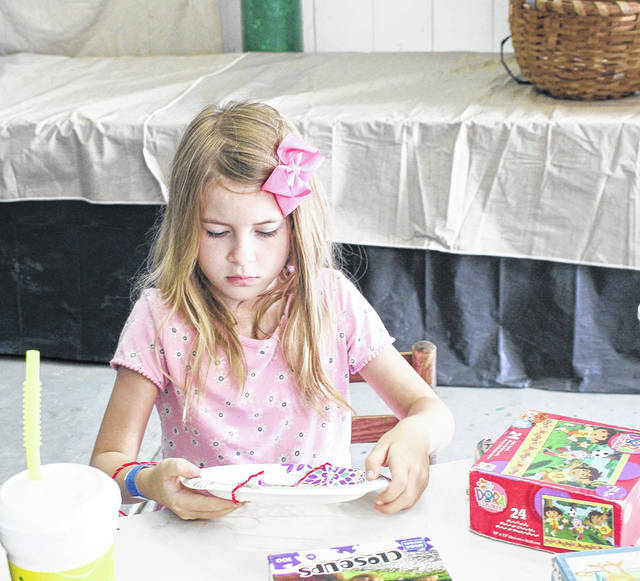 Kamryn Dahlinghaus, daughter of Tabitha Duckro and Time Dahlinghaus, of Sidney, creates a Dream Catcher at the Girl Scout building. She is a member of Girl Scout Troop 21235.